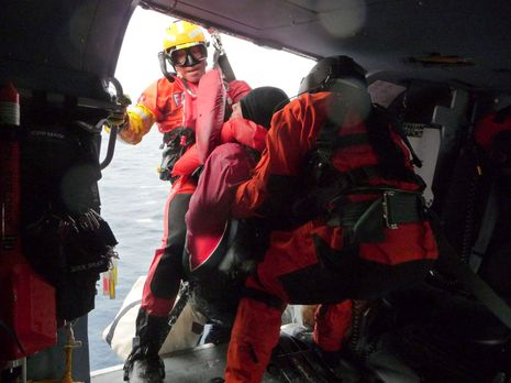 USCG_SAR_Jayhawk_crew_courtesy_Charles_Doane.jpg